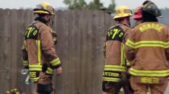 Firefighters walking, standing & talking Stock Footage