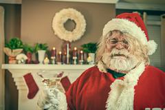 Bad santa getting wasted on christmas Stock Photos