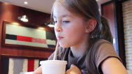 Stock Video Footage of Nice young girl  drinks from plastic cup through straw