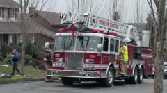 Fire engine, firefighters and investigator Stock Footage