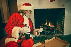 Bad santa reheating pizza in the fireplace Stock Photos