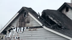 House fire damage:  roof and siding Stock Footage