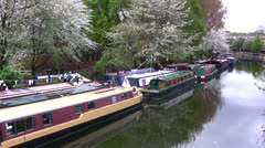 Narrow Boat Barges moored on Regents canal in London Stock Footage