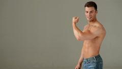 Muscular Man Showing His Biceps Stock Footage