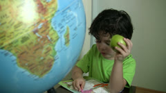 Little boy concentrating - stock footage