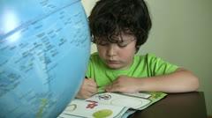 Child doing homework Stock Footage
