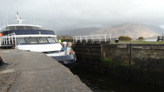 Boat leaving Caledonian Canal Fort William Scotland Stock Footage