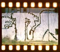 aged street wall background. film strip - stock illustration