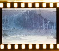 Stock Illustration of aged street wall background. film strip