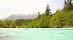 Kayakers on emerald river Stock Footage