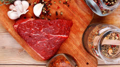 Fresh raw beef meat fillet flesh with peppercorn and spices in g Stock Footage