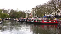 Barges lined up at a boat show in London Stock Footage