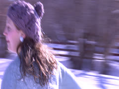 A couple's play in the snowfall Stock Footage