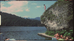 Vintage 8 mm film: Children jumping in lake, 1970s Stock Footage