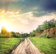 Country road and open land Stock Photos