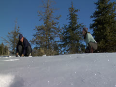 A couple with snow fight seen in low angle full two shot Stock Footage