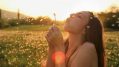 Young Female Model Blowing Dandelion Laughing on a Summer Field HD - stock footage
