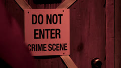Do not enter crime scene sign on door Stock Footage