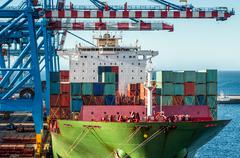 Loading container ship Stock Photos
