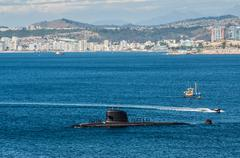 submarine arriving at port - stock photo