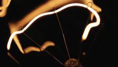 Real light bulb flickering. - stock footage