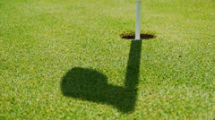 Golf - shadow from target flag moving in the wind Stock Footage