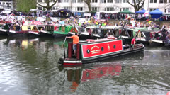 Barge canal boat reversing and turning at boat show in London Stock Footage