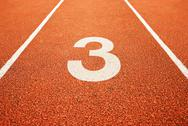 Stock Photo of number three on running track