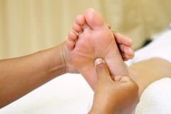 Reflexology foot massage, spa foot Stock Photos