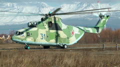 The huge cargo military MI-26 helicopter goes on a concrete path Stock Footage
