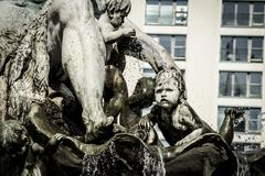 sad child from neptune fountain - stock photo