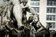 Sad child from neptune fountain Stock Photos