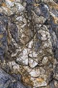 macro detail of layered multi color rock - stock photo
