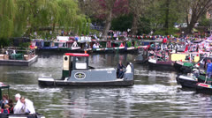 Small tug boat navigating on a canal at boat festival in London Stock Footage