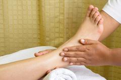 reflexology foot massage, spa foot - stock photo