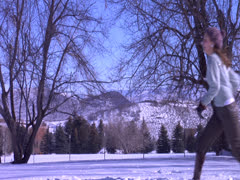 A duo snow fight in full shot plays and kisses each other Stock Footage