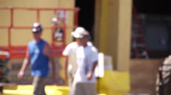 Construction workers walking  blurred Stock Footage