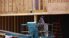 Construction worker with nail gun Stock Footage