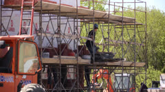 Construction worker on scaffolding - stock footage