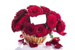 Roses in a wicker basket Stock Photos