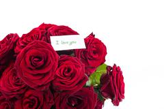 Red roses with a declaration of love Stock Photos