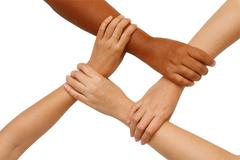 hand coordination,multiracial hands holding  in unity - stock photo