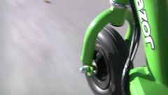 Electric Scooter POV Driving Riding Down Sidewalk Outdoors Transportation Green Stock Footage