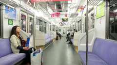 Underground car with sitting passengers, Tokyo, Japan Stock Footage