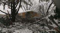 Snowstorm damage to tree and fence. - stock footage