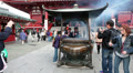 Incense burner with people burning aromatic sticks, Asakusa, Japan Footage