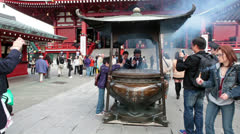 Stock Video Footage of Incense burner with people burning aromatic sticks, Asakusa, Japan