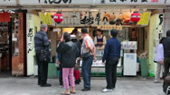Stock Video Footage of People looking at shopwindow in Nakamise-dori, Senso-ji shrine, Tokyo, Japan