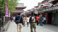 Visitors going to Senso-ji temple throuth the Nakamise-dori, Tokyo, Japan Footage