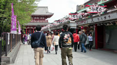 Visitors going to Senso-ji temple throuth the Nakamise-dori, Tokyo, Japan Stock Footage